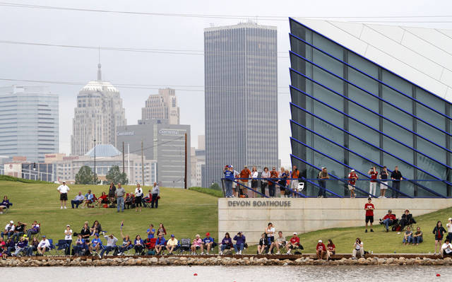 A crowd watches April 28 from the shoreline of the Oklahoma River during the Big 12 Rowing Championships in Oklahoma City.  Photo by Bryan Terry,  The Oklahoman