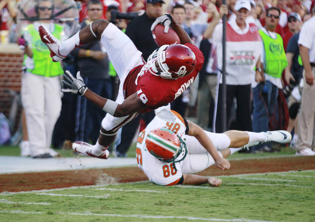 Oklahoma wide receiver Justin Brown (19) is tripped up by Florida A&M's Branden Holdren (86) short of the goal line during the first quarter of an NCAA college football game in Norman, Okla., Saturday, Sept. 8, 2012. (AP Photo/Sue Ogrocki)