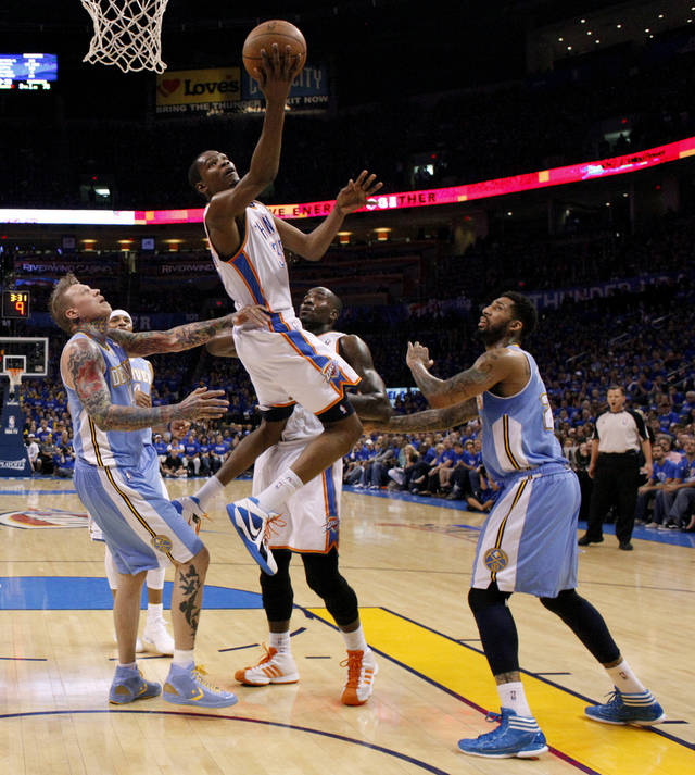 Oklahoma City's Kevin Durant (35) goes to the basket between Denver's Chris Andersen (11) and Wilson Chandler (21) as Kendrick Perkins (5) watches  during the NBA basketball game between the Denver Nuggets and the Oklahoma City Thunder in the first round of the NBA playoffs at the Oklahoma City Arena, Sunday, April 17, 2011. Photo by Bryan Terry, The Oklahoman