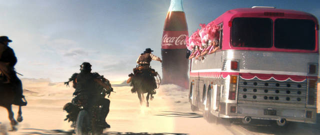 This frame grab provided by Coca Cola, shows a moment in the Super Bowl 2013 Coca Cola campaign. The campaign, which will include TV spots as well as a Web site and interaction with consumers on social media sites like Twitter and Instagram, is the beverage maker's latest attempt to capture interest of people who watch the Big Game with a second screen such as a tablet or smartphone nearby.  (AP Photo/Coca Cola)