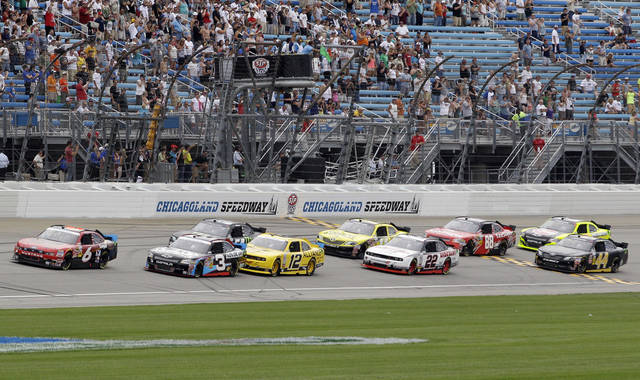 Ricky Stenhouse Jr., (6) leads the pack at the start of the NASCAR Nationwide Series auto race at Chicagoland Speedway in Joliet, Ill., Sunday, July 22, 2012. (AP Photo/ Nam Y. Huh)