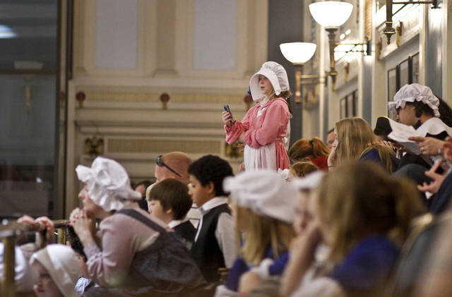 Ariana Hansen takes video while listening to a lecture in the Senate chamber as more than 500 fifth grade students from across the state celebrated colonial history during Colonial Day at the state Capitol on Friday, Feb. 3, 2012, in Oklahoma City, Okla. Photo by Chris Landsberger, The Oklahoman