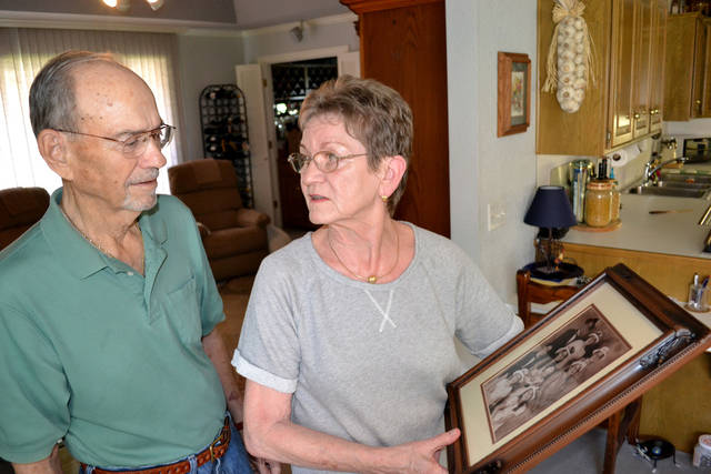 Pat and Patricia Pattillo talk about their family history while looking at a portrait of their grandchildren Thursday at their home in Oklahoma City. Photo by Zeke Campfield, The Oklahoman