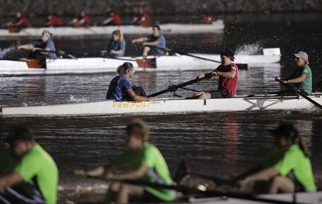 Rowing teams compete during the Oklahoma Regatta Festival Night Sprints on the Oklahoma River in Oklahoma City, Thursday, Sept. 27, 2012.  Photo by Garett Fisbeck, The Oklahoman