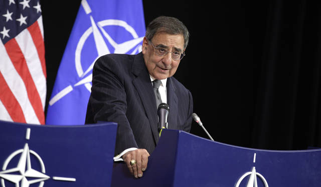 United States Secretary of Defense Leon Panetta speaks during a media conference at NATO headquarters in Brussels on Wednesday, April 18, 2012. The United States and its NATO allies are readying plans to pull away from the front lines in Afghanistan next year as President Barack Obama and fellow leaders try to show that the unpopular war is ending. (AP Photo/Virginia Mayo)