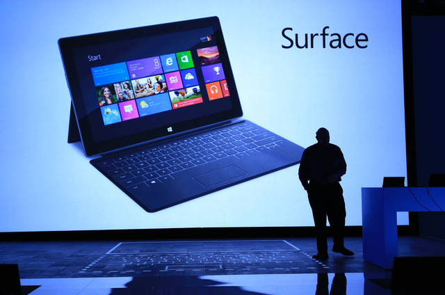 COMMERCIAL IMAGE - In this photograph taken by AP Images for Microsoft, Steve Ballmer, Microsoft Chief Executive Officer, reveals Surface, a new family of PCs, for Windows, Monday, June 18, 2012, in Los Angeles. (Rene Macura/AP Images for Microsoft)