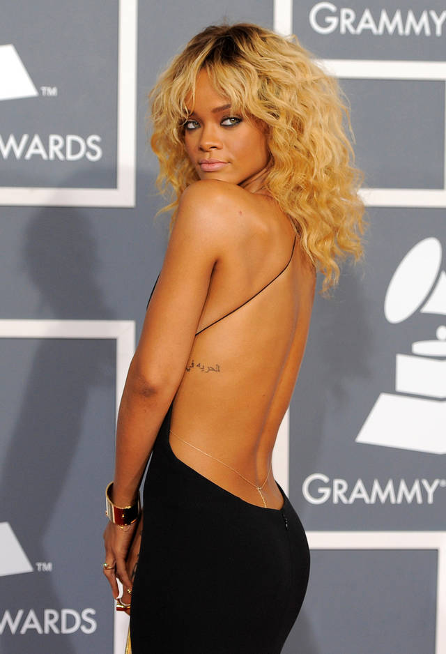 FILE - This Feb. 12, 2012 file photo shows Rihanna at the 54th annual Grammy Awards in Los Angeles. CBS has issued a memo to Grammy Awards attendees against baring too much skin at the ceremony Sunday. The network requests that �buttocks and female breasts are adequately covered� for the televised award show. The memo sent out Wednesday, Feb. 6, 2013, also warned against �see-through clothing,� exposure of �the genital region� and said that �thong type costumes are problematic.� (AP Photo/Chris Pizzello, file)