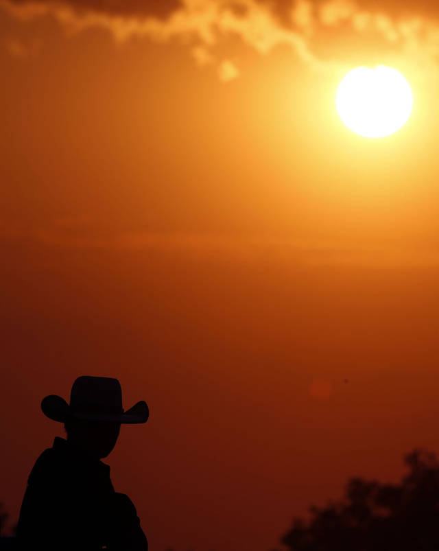 A cowboy waits for the beginning of the International Finals Youth Rodeo in Shawnee, Okla., Friday, July 13, 2012. Photo by Sarah Phipps, The Oklahoman