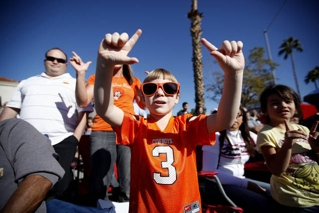 Conner Quintero, 4, of Enid, Okla., cheers during the Fiesta Bowl parade in Phoenix, Ariz., Saturday, Dec. 31, 2011. Photo by Sarah Phipps, The Oklahoman