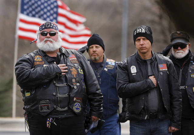 Veterans who arrived at the funeral on motorcycles, honor Rex Schad as his casket is taken from the church. Celebration of Life service  for US Army SSgt. Rex L. Schad at LifeChurch.tv in Edmond Thursday afternoon,  March 21, 2013.  Schad was killed earlier this month while conducting a patrol brief with the Afghanistan National Police.  He is a 2005 graduate of Edmond Memorial High School.    Photo by Jim Beckel, The Oklahoman