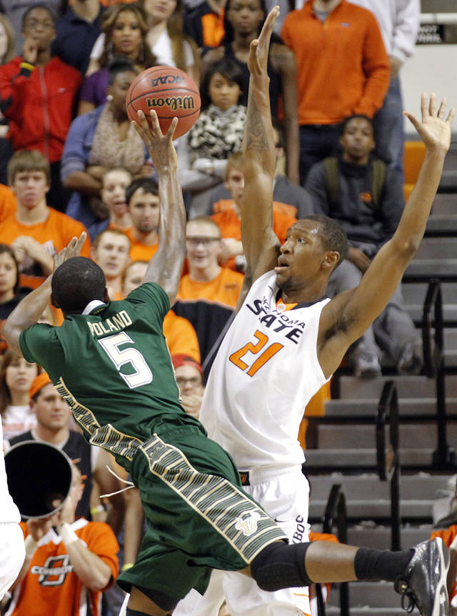 Oklahoma State 's Kamari Murphy (21) defends on South Florida Bulls' Jawanza Poland (5) during the college basketball game between Oklahoma State University (OSU) and the University of South Florida (USF) on Wednesday , Dec. 5, 2012, in Stillwater, Okla.   Photo by Chris Landsberger, The Oklahoman