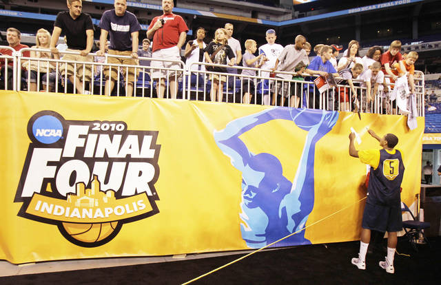 West Virginia's Kevin Jones (5) signs autographs during a practice session for this year's NCAA Final Four in Indianapolis in March. The NCAA Tournament will expand to 68 teams and be aired by CBS and Turner networks TBS, TNT and truTV. AP PHOTO
