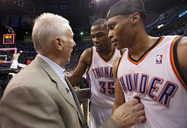 San Antonio coach Gregg Popovich, left, talks with Oklahoma City's Kevin Durant, center, and Russell Westbrook Wednesday after the Thunder clinched the Western Conference Finals. Photo by Chris Landsberger, The Oklahoman