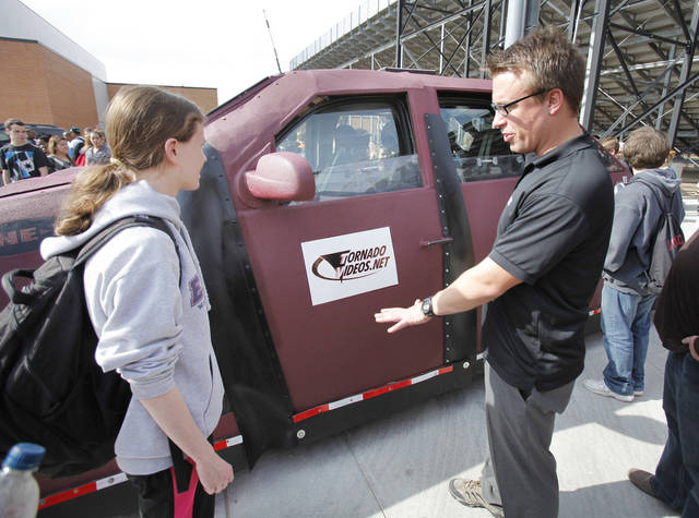 Discovery Channel's Reed Timmer talks with Norman High School sophomore Emily Black as he and his storm chasing vehicles, Dominator 1 and 2, are on display at Norman High School on Thursday, Feb. 2, 2012, in Norman, Okla.  Photo by Steve Sisney, The Oklahoman