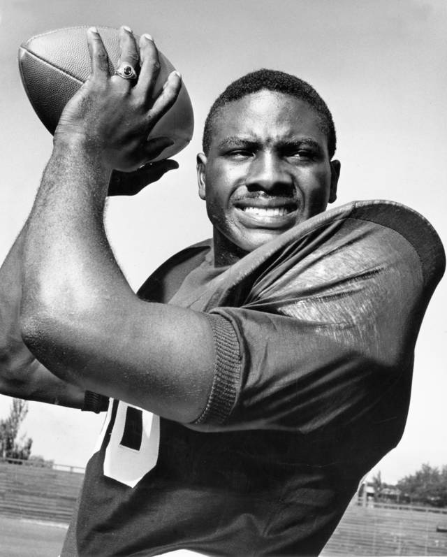 "OU COLLEGE FOOTBALL: Power runner and key blocker in the University of Oklahoma's punishing ground attack is senior fullback Prentice Gautt, All-America candidate from Oklahoma City's Douglass High School. Staff photo by Richard ""DIck"" Cobb taken 8/31/1959; photo ran in The Daily Oklahoman on 10/24/1959, 7/21/1963 and 9/16/1963."