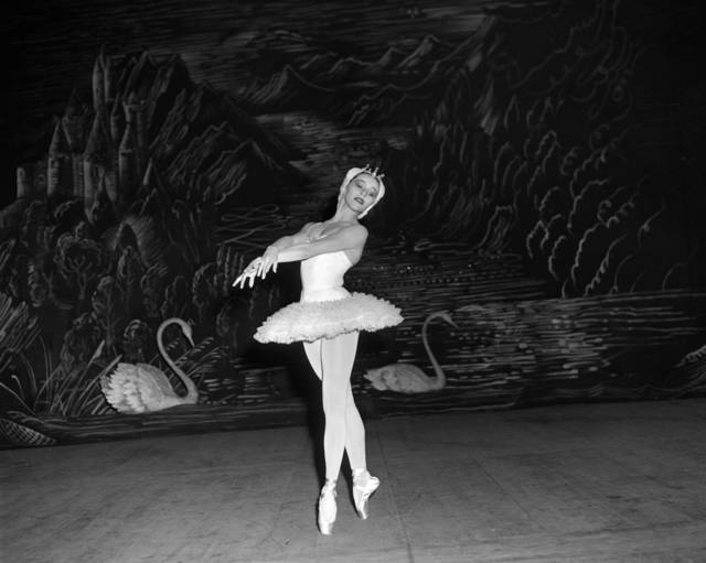 "FILE - This Sept. 14, 1953 file photo shows Maria Tallchief, prima ballerina of the New York City Ballet, in Tschaikowsky's ""Swan Lake"" during the opening performance of the company's engagement at the Scala Theater in Milan, Italy. Tallchief died  died Thursday, April 11, 2013, in Chicago at the age of 88. Tallchief joined the company that would become the New York City Ballet in 1948. She was married for a time to George Balanchine, who founded the School of American Ballet in New York. Tallchief worked with Balanchine on such masterpieces as 1949's ""Firebird"" and his now-historic version of ""The Nutcracker."" (AP Photo, file) ORG XMIT: NYET273"