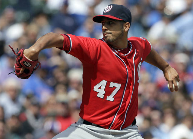 Washington Nationals starter Gio Gonzalez delivers a pitch during the first inning of a baseball game against the Chicago Cubs in Chicago, Saturday, April 7, 2012. (AP Photo/Nam Y. Huh)