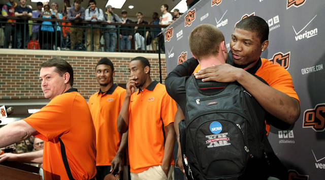 OSU basketball players Le'Bryan Nash, Markel Brown and Marcus Smart delighted  fans when they announced at a noontime press conference they intend to return for another season as members of the Cowboys basketball team. Cheering fans lined all levels in the Student Union atrium Wednesday, April 17, 2013.    by Jim Beckel, The Oklahoman.
