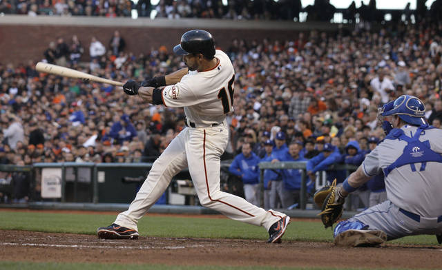 San Francisco Giants' Angel Pagan hits a single to score Ryan Theriot off Los Angeles Dodgers pitcher Nate Eovaldi during the second inning of a baseball game in San Francisco, Monday, June 25, 2012. At right is Dodgers catcher A.J. Ellis. (AP Photo/Jeff Chiu)