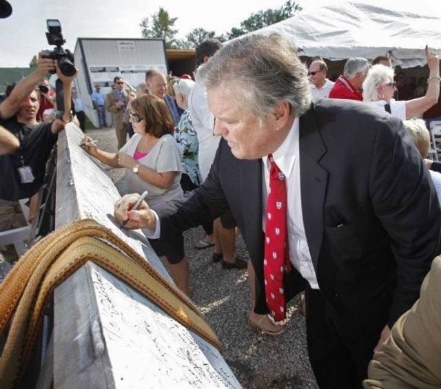 HEADINGTON HOUSING / DONOR / DONATED / DONATION / OU: Tim Headington signs a beam as he participates in a beam raising/groundbreaking ceremony for a new student housing center on the campus of the University of Oklahoma on Friday, Sept 2, 2011, in Norman, Okla.  Headington is the major donor. Photo by Steve Sisney, The Oklahoman ORG XMIT: KOD