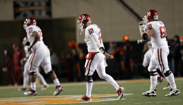 Oklahoma's Landry Jones (12) walks off the field after throwing a touchdown during the Bedlam college football game between the Oklahoma State University Cowboys (OSU) and the University of Oklahoma Sooners (OU) at Boone Pickens Stadium in Stillwater, Okla., Saturday, Dec. 3, 2011. Photo by Sarah Phipps, The Oklahoman