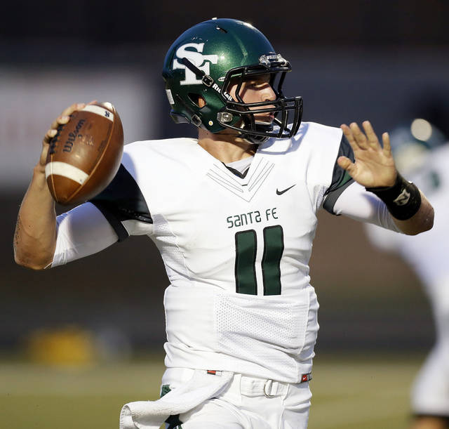 Edmond Santa Fe's Justice Hansen (11) passes during a high school football game between Mustang and Edmond Santa Fe in Mustang, Okla., Friday, Sept. 28, 2012. Photo by Nate Billings, The Oklahoman
