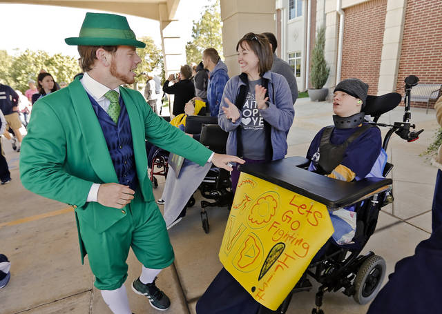 "The Notre Dame mascot greets patients as the ""Band of The Fighting Irish,"" along with the spirit squads and mascot put on a special performance for the patients and employees of The Children's Center on Friday, Oct. 26, 2012, in Bethany, Okla. Photo by Chris Landsberger, The Oklahoman"