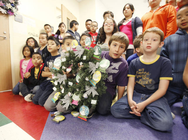 Teacher Drue Stogner's fourth grade class poses for a photo with their wreath at Fillmore Elementary School in Oklahoma City, OK, Tuesday, Nov. 15, 2011. All the students at Fillmore Elementary created 30 wreaths which Integris will auction off, with all the money going back to the school. By Paul Hellstern, The Oklahoman