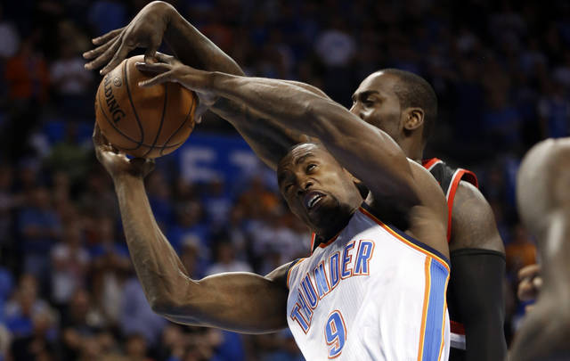Serge Ibaka is fouled on a shot by J.J. Hickson as the Oklahoma City Thunder play the Portland Trail Blazers in NBA basketball at the Chesapeake Energy Arena in Oklahoma City, on Friday, Nov. 2, 2012.  Photo by Steve Sisney, The Oklahoman