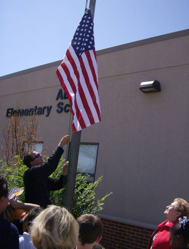 Raising the flag. (Photo provided)