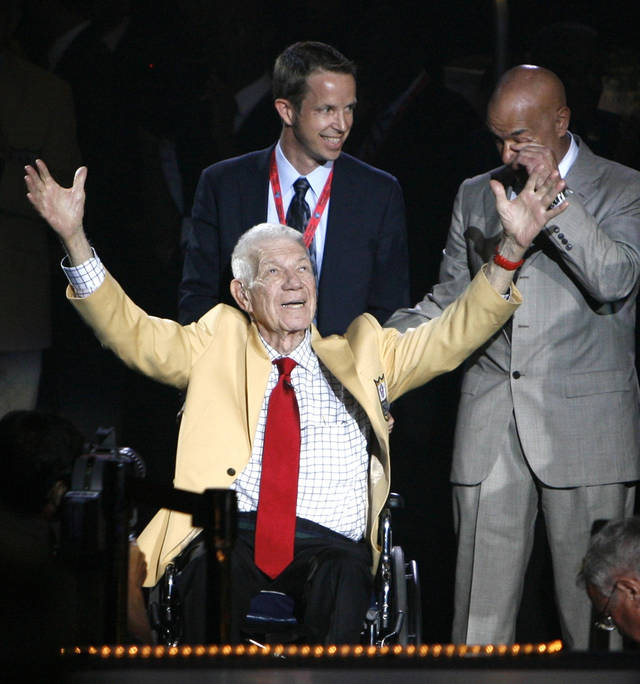 Founder, President, Chairman 1964-1995 of NFL Films Ed Sabol acknowledges the applause of fans after receiving his gold jacket Friday Aug. 5, 2011, during the Pro Football Hall of Fame Festival inductees dinner at the Canton Civic Center in Canton, Ohio. Sabol will be inducted into the Pro Football Hall of Fame on Saturday, along with Richard Dent, Marshall Faulk, Chris Hanburger, Les Richter, Deion Sanders, and Shannon Sharpe. (AP Photo/The Repository, Bob Rossiter)