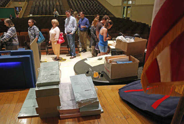 Voting ballots are stacked and ready as voters wait in line to cast their ballot Tuesday, June 5, 2012, in Milwaukee. Wisconsin Republican Gov. Scott Walker is taking on Democratic challenger Tom Barrett in a recall election. (AP Photo/Jeffrey Phelps)
