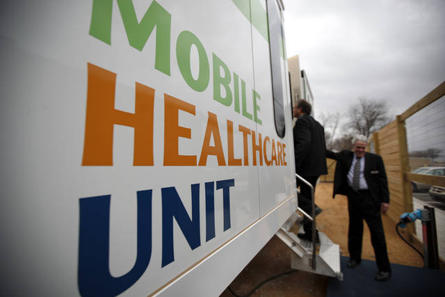 Fred Loper, M.D., leads a tour of a moble health care unit during a dedication for the Mobile Healthcare Ministry and Charitable Clinic in Oklahoma City , Tuesday, Jan. 24, 2012. Photo by Sarah Phipps, The Oklahoman
