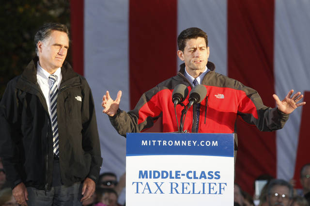 Republican vice presidential candidate, Rep. Paul Ryan, R-Wis., right, speaks as Republican presidential candidate, former Massachusetts Gov. Mitt Romney, listens during a campaign rally in Lancaster, Ohio, Friday, Oct. 12, 2012. (AP Photo/Paul Vernon)