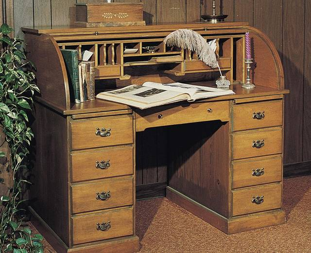 The pedestal base holds seven big drawers and two pullout drawing boards. On top, 16 pigeonholes are perfect for sorting and filing, and two small drawers hold postage, pens and other supplies. Best of all, at the end of the day simply pull down the tambour cover to conceal and secure work-in-progress. Photo provided