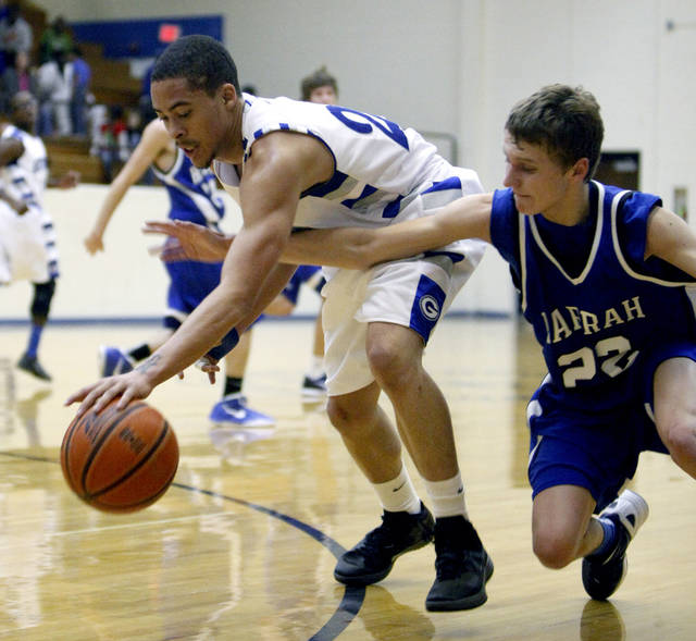Harrah's Zack Manek and Guthrie's Codee Gross fight for a loose ball during the high school basketball game between Guthrie and Harrah at Guthrie, Okla.., Tuesday, Dec. 20, 2011. Photo by Sarah Phipps, The Oklahoman