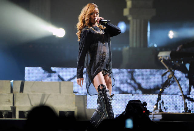 Singer Rihanna performs at the Barclays Center on Tuesday, May 7, 2013 in New York. (Photo by Evan Agostini/Invision/AP) ORG XMIT: NYEA105