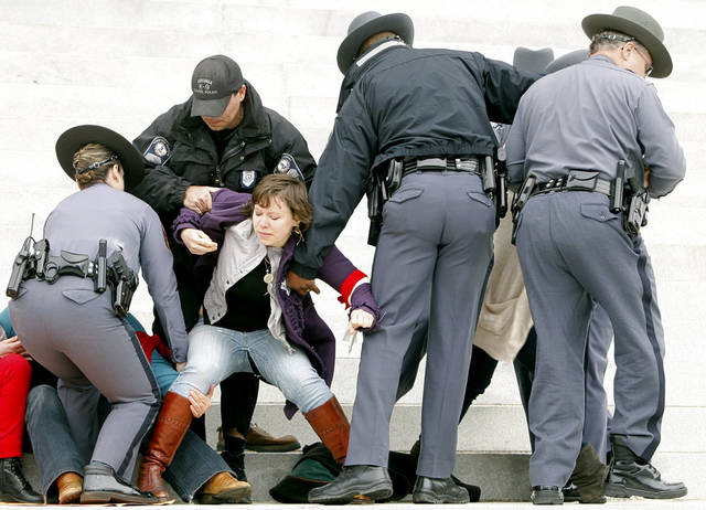 Protesters are removed from the front steps of the State Capitol in Richmond, Va., Saturday, March 3, 2012. Virginia Capitol Police arrested more than 30 women�s rights activists Saturday when they refused to leave the Capitol steps during a protest of anti-abortion legislation. The protesters were some of an estimated 500 who had marched down a downtown street before gathering on the Capitol grounds to protest legislation like a bill that passed the General Assembly earlier in the week that requires an ultrasound before an abortion.  (AP Photo/Richmond Times-Dispatch, Eva Russo)