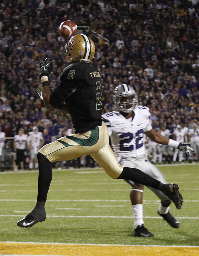 Baylor wide receiver Terrance Williams (2) catches a touchdown pass against Kansas State defensive back Dante Barnett (22) during the first half of an NCAA college football game Saturday, Nov. 17, 2012, in Waco Texas. (AP Photo/LM Otero)