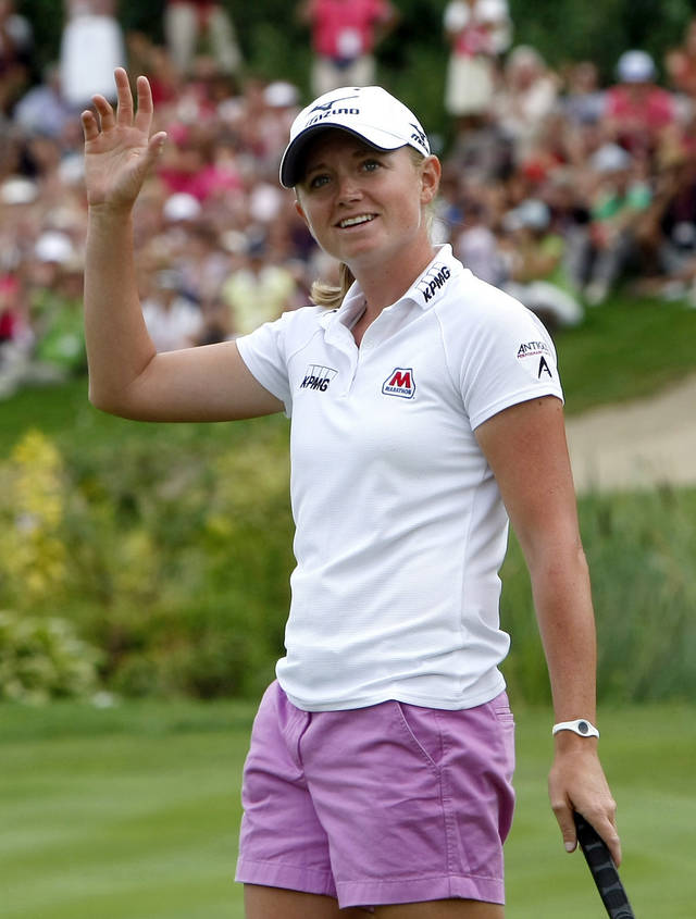 FILE - In this July 29, 2012, file photo, Stacy Lewis of United States, reacts at the 18th hole during the Evian Masters women's golf tournament in Evian, eastern France. The 27-year-old heads to the LPGA Tour finale for somewhat of a victory lap. She's the first American since 1994 to win LPGA player of the year. (AP Photo/Claude Paris, File)