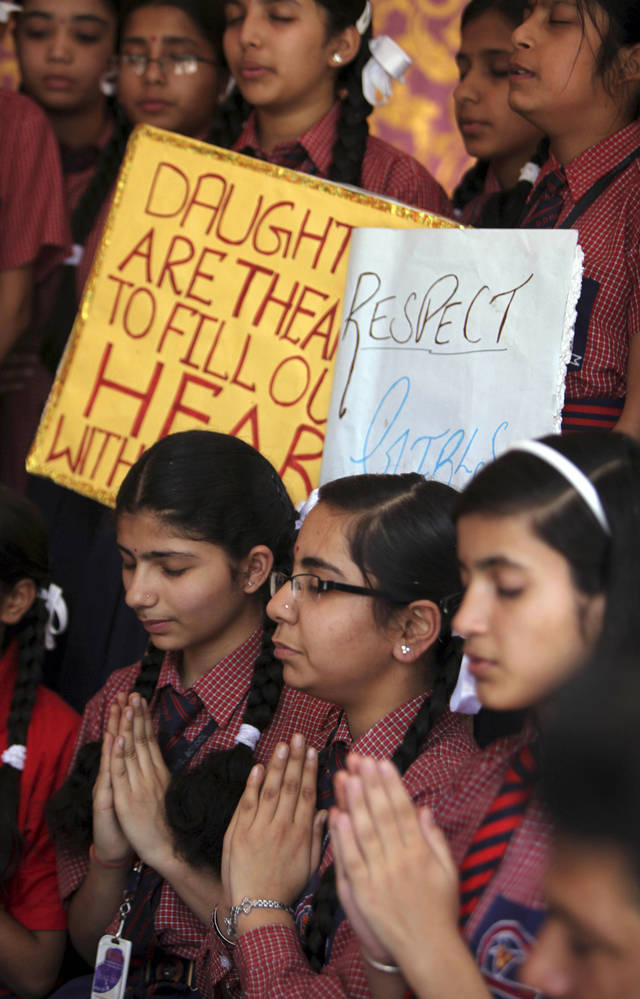 Indian schoolgirls offer prayers for the speedy recovery of a 5-year-old girl who was raped and tortured in New Delhi, at Dewan Devi Public School in Jammu, India, Monday, April 22, 2013. A second suspect was arrested Monday in the rape of the girl who New Delhi police say was left for dead in a locked room, a case that has brought a new wave of protests against how Indian authorities handle sex crimes. (AP Photo/Channi Anand)