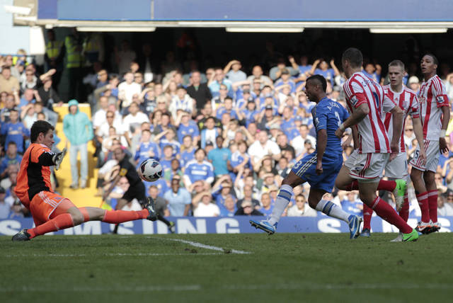 Chelsea's Ashley Cole, fourth right, shoots pass Stoke City's goalkeeper Asmir Begovic, left, to score during their English Premier League soccer match at Stamford Bridge, London, Saturday, Sept. 22, 2012. (AP Photo/Sang Tan)
