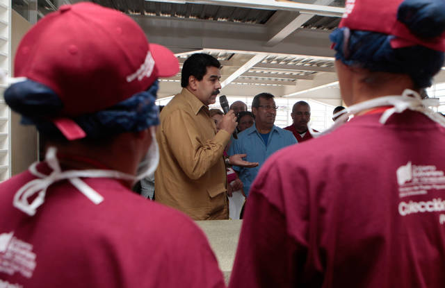 In this photo released by Miraflores Press Office, Venezuela's Vice President Nicolas Maduro, center,  speaks to students during the inauguration of a school in Barinas, Venezuela, Friday, Jan. 18, 2013. Venezuela's vice president stepped into the shoes of ailing President Hugo Chavez in a flurry of public events Friday, working to maintain an image of government continuity after more than five weeks of unprecedented silence from the normally garrulous president. (AP Photo/Miraflores Press Office)