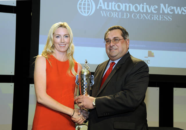 In this photo taken Wednesday, Jan. 11, 2012, and released by BorgWarner, Susie Wheldon, left, widow of IndyCar driver Dan Wheldon, accepts the BorgWarner Championship Drivers' Trophy on her late husbandís behalf from BorgWarner chief executive Timothy Manganello at a ceremony in Detroit during the Automotive World Congress. Dan Wheldon, a two-time Indianapolis 500 winner, was killed in a 15-car accident in the opening laps of the Oct. 16, 2011, IndyCar season finale at Las Vegas Motor Speedway. (AP Photo/BorgWarner, Patrick R. Bafile)