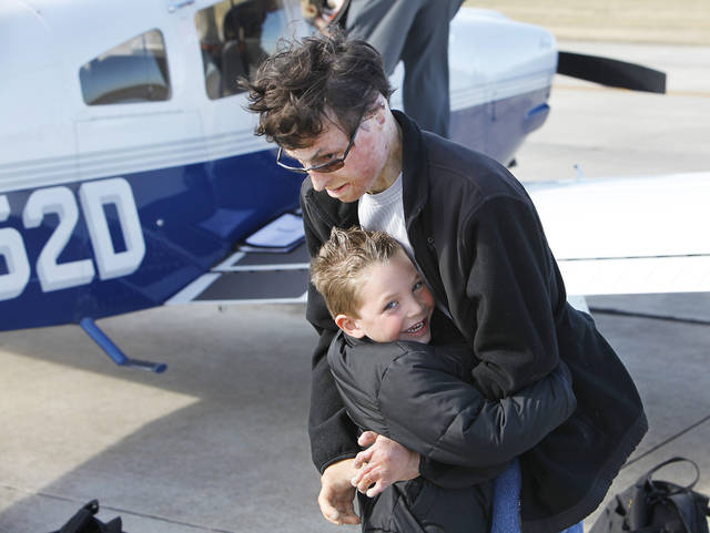 Matt Cole gets a hug from his nephew Noah Kasin, 4, from Edmond, after taking and passing his Medical Flight test at Wiley Post Airport, Monday,  November 8, 2010.  Cole was a professional pilot and was injured in a plane crash 10 years ago and has now passed all the tests to get his pilot's license back. Photo by David McDaniel, The Oklahoman