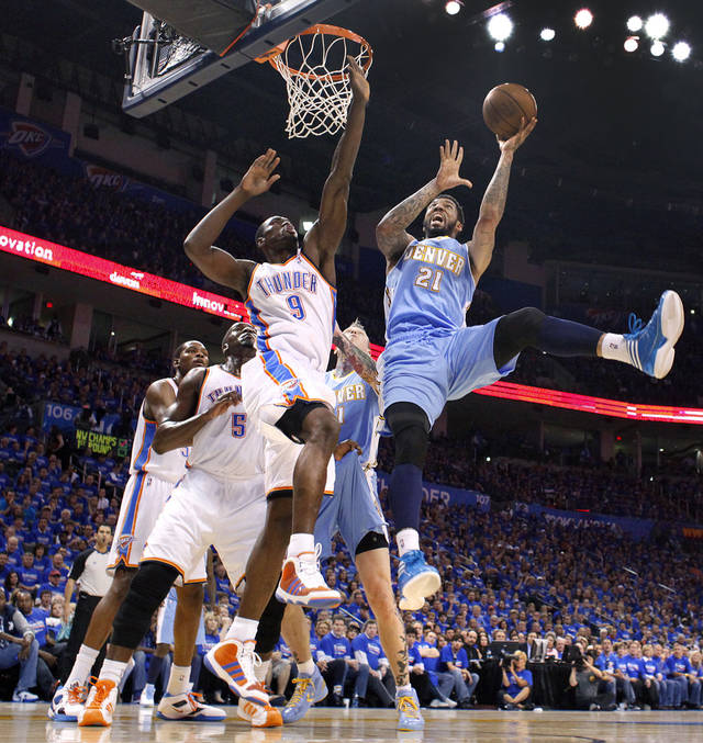 Denver's Wilson Chandler (21) puts up a shot over Oklahoma City's Serge Ibaka (9) during the first round NBA playoff game between the Oklahoma City Thunder and the Denver Nuggets on Sunday, April 17, 2011, in Oklahoma City, Okla. Photo by Chris Landsberger, The Oklahoman
