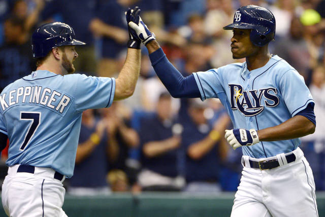 Tampa Bay Rays' B.J. Upton, right, is congratulated by Jeff Keppinger after hitting a home run during the fourth inning of a baseball game against the Texas Rangers in St. Petersburg, Fla., Sunday, Sept. 9, 2012. (AP Photo/Phelan M. Ebenhack)