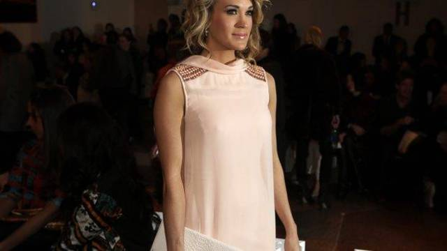 Carrie Underwood at the Peter Som fall 2014 runway show in New York. AP PHOTO