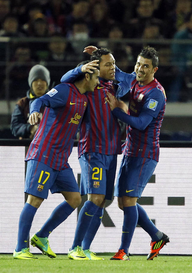 Spain's FC Barcelona midfielder Adriano, center, celebrates with teammates Pedro Rodriguez, left, and David Villa after scoring a goal against Qatar's Al-Sadd Sports Club in the first half of their semifinal match at the Club World Cup soccer tournament in Yokohama, near Tokyo, Thursday, Dec. 15, 2011. (AP Photo/Koji Sasahara)