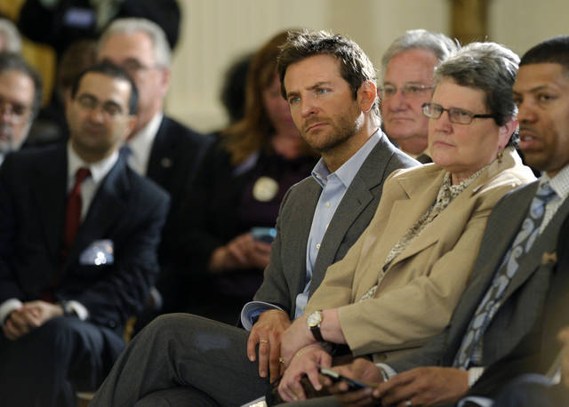 Actor Bradley Cooper, center, listens during a panel discussion at the National Conference on Mental Health, Monday, June 3, 2013, in the East Room of the White House in Washington. Cooper and Glenn Close were among those gathering at the White House for a conference on mental health, organized as part of President Barack Obama's response to last year's shooting massacre at a Connecticut elementary school. (AP Photo/Susan Walsh)